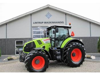 Wheel tractor CLAAS AXION 830 CMATIC med frontlift og front-PTO