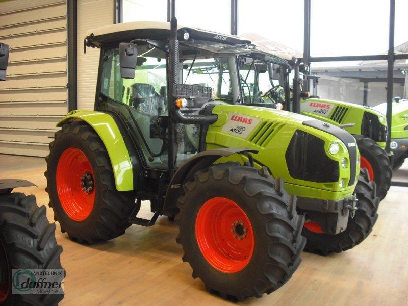 wheel tractor CLAAS Atos 330 MRC