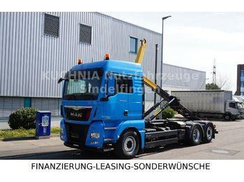 Ciężarówka hakowiec MAN TGX 26.480 6x2 BL Abrollkipper Pal T20 Lenkachse