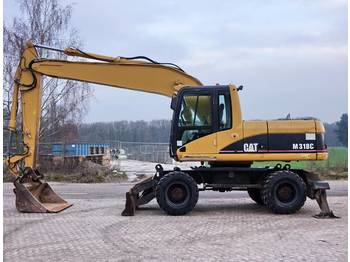 CATERPILLAR M318C - wheel excavator