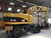 Caterpillar M318 C - wheel excavator