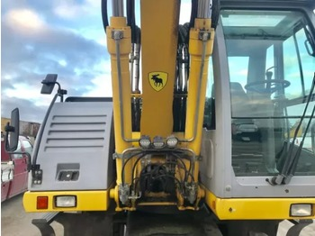 NEW HOLLAND MH City - wheel excavator