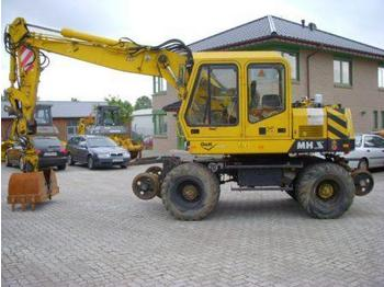 O&K MH S ZW  (28) railroad excavator - wheel excavator