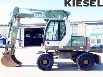 O&K MH City - pelle sur pneus