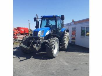 New Holland TS 100A - riteņu traktors