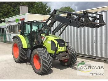 Claas AXOS 310 C - колёсный трактор