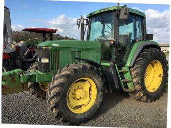 Колёсный трактор John Deere 6600