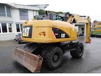 Колёсный экскаватор Caterpillar M 313 D: фото 1