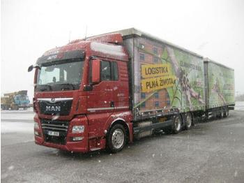 Curtainsider truck  MAN - TGX 24.460 +Schwarzmüller JUMBOZUG