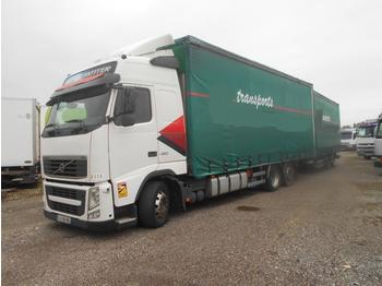 Curtainsider truck Volvo FH12 460