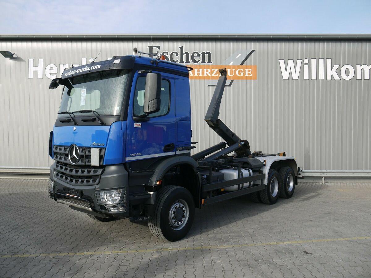 hook lift truck Mercedes-Benz Arocs 3348 AK 6x6 BB, Meiller RK 20.65, 1. Hand